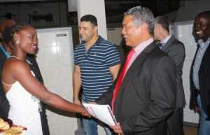 Minister Given Lubinda greetings sensational zambian women boxer Catherine Phiri while looking on is Oriental Director Ahmed Saadi and Oriental Chief of Operations Chris Malunga