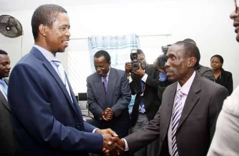 President Edgar Chagwa Lungu congratulates Chawama constituency PF parliamentary candidate Lawrence Chalwe at Chawama Basic school on March 10,2015, where the President witnessed the filling in of nomination papers of Chawama Constituency