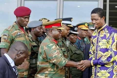 President Edgar Chagwa Lungu (right) greets Army Commander Lt. General Paul Mihova before leaving Heroes Stadium in Lusaka,Zambia on Sunday,March 8,2015