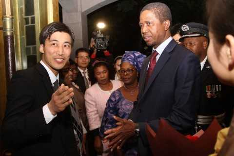 President Edgar Lungu and First Lady Esther Lungu listens to Hong Qiao State Guest House's manager of building number two Ivan Lu on arrival at the State Guest House in Shanghai, China
