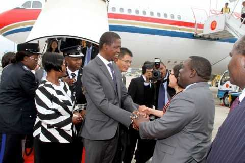 President Edgar Lungu greets Foreign affairs minister Harry Kalaba on arrival at Sanya Phoenix International Airport for Boao forum in Hainan Province of China on March 27,2015 -Picture by THOMAS NSAMA