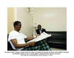 President Edgar Lungu reads the Times of Zambia Newapaper in Maina Soko Military Hospital on Monday, March 9,2015. On the right is Daniel Siwo, his Private Secretary -Picture by SALIM HENRY