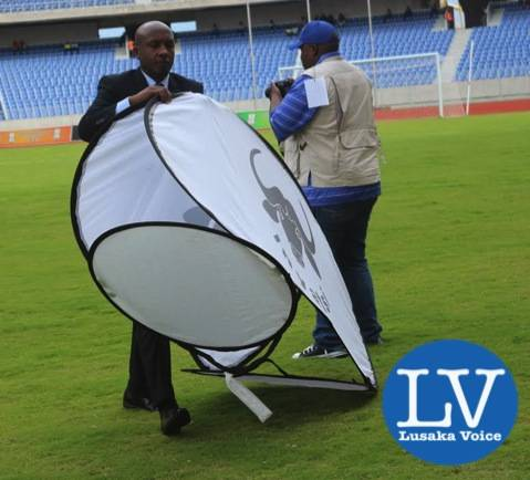 Rwanda Match Commissioner Celestin Ntagungira moving out of the ground an advertising banner   - Photo Credit Jean Mandela - Lusakavoice.com