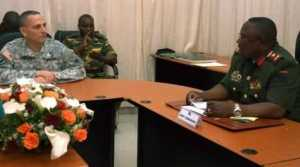 U.S. Army Africa Deputy Commanding General, Brig. Gen. Peter L. Corey engages with Lt. Gen. Paul Mihova, commander of the Zambian Army during a meeting at the Zambian Ministry of Defense.