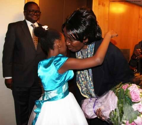 Zambia Vice-President Her Honour Mrs Inonge Wina (right) hugs eight-year-old Tasheni Bota on arrival at New York Palace Hotel in New York on Sunday, March 8, 2015. Looking on is Zambia's Ambassador to the US His Excellency Mr. Palan Mulonda. The Vice-President is leading the Zambian delegation to the 59th Session of the Commission on the Status of Women. PHOTO   CHIBAULA D. SILWAMBA   ZAMBIA UN MISSION