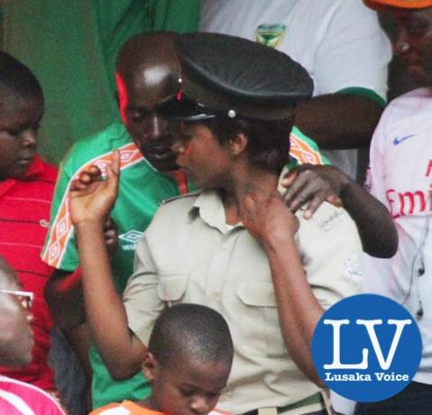 a Supporter talking to a police woman - Photo Credit Jean Mandela - Lusakavoice.com