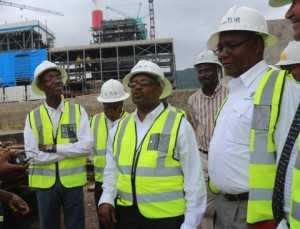 in the middle wearing glasses- ZESCO acting MD Victor Mundende