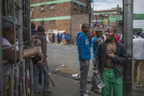An African immigrant holds a machete in a run-down district of east Johannesburg(Siphiwe Sibeko:Reuters)