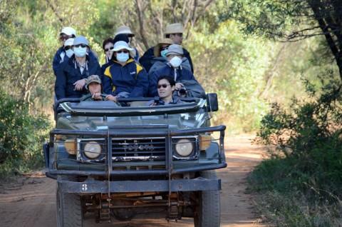 Chinese tourists on safari by Alan_Kolnik