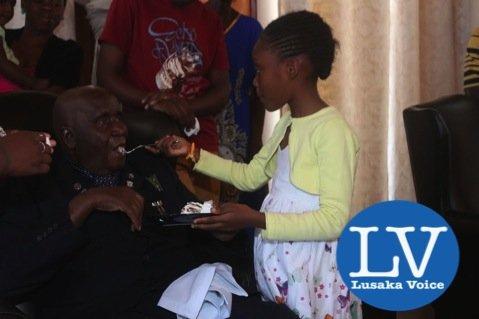 KK grand daughter Tiyezye Kaunda does feed him - Photo Credit Jean Mandela - Lusakavoice.com