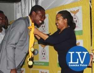 Kitwe based MTN entrepreneurship Manager Rebecca Mwila crowining Power Dynamos goal Keeper Joshua Titima with a sliver medal!  - Photo Credit Jean Mandela - Lusakavoice.com