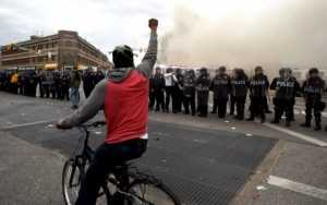 Police Watch as Baltimore Burns