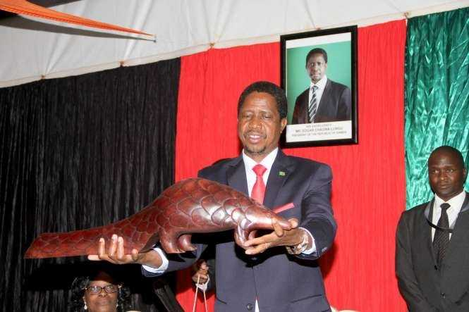 President Edgar Chagwa Lungu displays a gift given to him by Zambian's living in Zimbabwe at Zambia's Ambassador to Zimbabwe's residence in Harare where he addressed them on April 29,2015 -Picture by THOMAS NSAMA