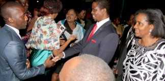 President Edgar Chagwa Lungu greets Zambians at Zambia's Ambassador to Zimbabwe's residence in Harare where he addressed them on April 29,2015 -Picture by THOMAS NSAMA