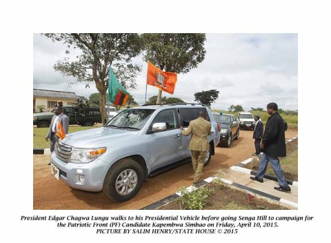 President Edgar Chagwa Lungu walks to his Presidential vehicle before going to Senga Hill Constituency to drum up support for the Patriotic Front (PF) Candidate Kapembwa Simbao on Friday, April 10, 2015.