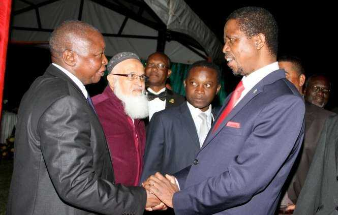 President Edgar Chagwa Lungu with Former Bank of Zambia Governor Caleb Fundanga at Zambia's Ambassador to Zimbabwe's residence in Harare where he addressed Zambia's leaving in Zimbabwe on April 29,2015 -Picture by THOMAS NSAMA