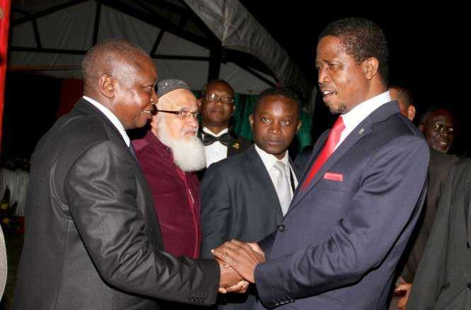 President Edgar Chagwa Lungu with Former Bank of Zambia Governor Caleb Fundanga at Zambia's Ambassador to Zimbabwe's residence in Harare where he addressed Zambia's living in Zimbabwe on April 29,2015 -Picture by THOMAS NSAMA