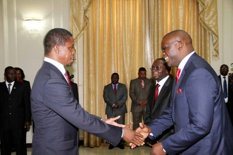 President Edgar Lungu congratulates newly appointed Attorney General Likando Kalaluka as Newly appointed Foreign Affairs Permanent Secretary Chalwe Lombe looks on during the Swearing in Ceremony at State House on April 8,2015
