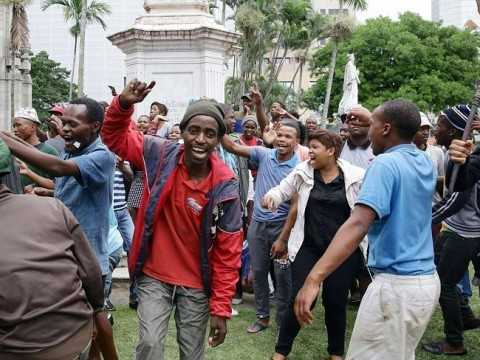 Rising anger ... demonstrators take part in an anti-xenophobia march outside the City Hall of Durban. Picture: AFP Photo / Rajesh Jantila Source: AFP