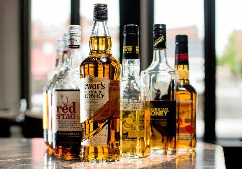 whisky, dollars