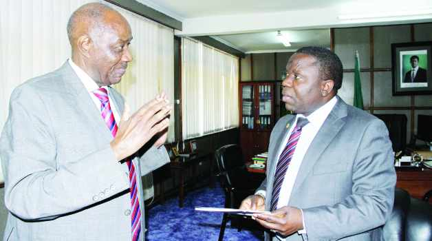 • VETERAN politician Vernon Johnson Mwaanga stressing a point when he paid a courtesy call on Foreign Affairs Minister Harry Kalaba at his office May 2015.