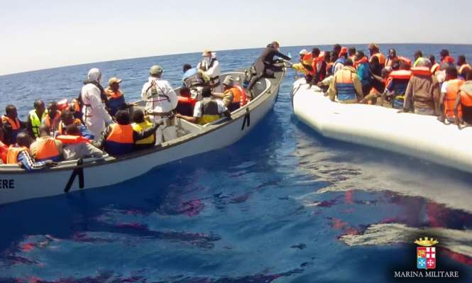 A picture from the Italian navy of one of the migrant rescues. Photograph: Ufficio Stampa Marina Militare / Italian Navy Press Office/Guardian