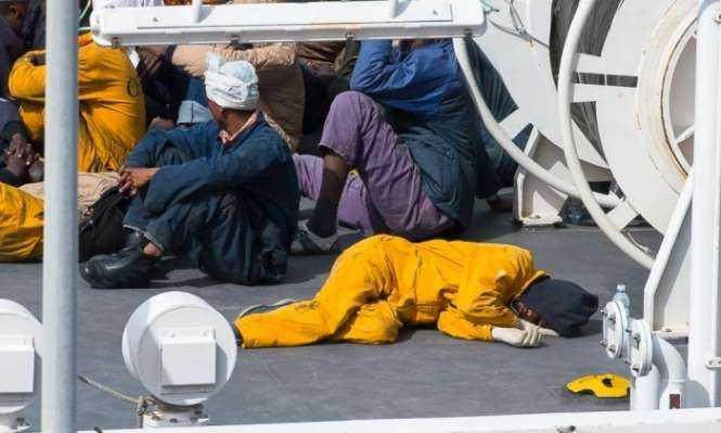 A survivor sleeps on the deck of the Italian coastguard vessel Bruno Gregoretti in the Maltese port of Senglea. Photograph- Ian Pace:Demotix:Corbis