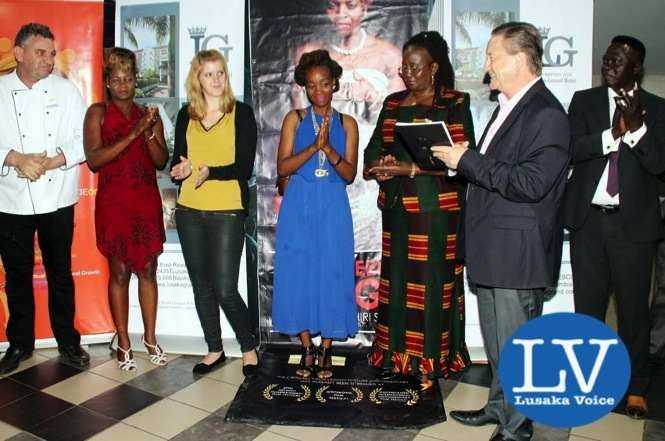 """Lusaka Grand Hotel Executive Chef Eric Buitendjik , Boxer Esther Phiri, Lusaka Grand Hotel  Media & Public Relations Manager Janina Baalmann ,  Documentary Production Director Jessie  Chisi, Minister of Community Development, Mother and Child Health, Hon. Emerine Kabanshi , Esther Phiri Fights Promoter Peter Cottan and trainer Anthony Mwamba posing for a picture after the """"Between Rings""""documentary premier at SterKinekor Film views"""