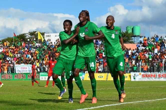#Fazfootball Image: Kondwani Mtonga celebrates scoring Zambia's second goal with Jackson Mwanza and Christopher Munthali.