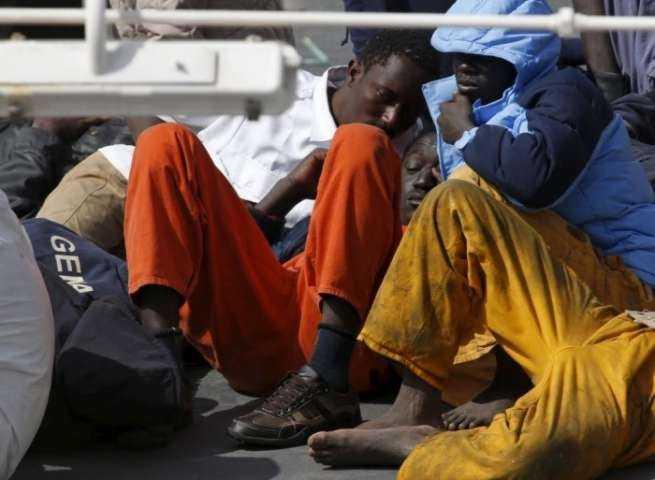 Migrants lie on the deck of the Italian coastguard ship Bruno Gregoretti in Senglea, Malta. Photograph- Darrin Zammit Lupi:Reuters