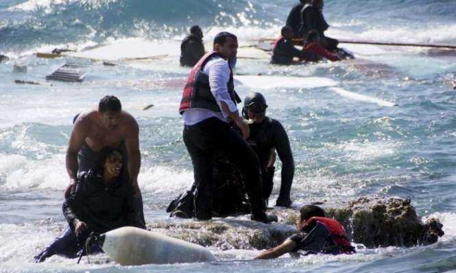 Migrants trying to reach Greece are rescued by members of the Greek coastguard and locals just off the island of Rhodes. Photograph- Eurokinissi:Reuters