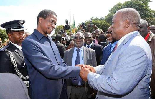President Edgar Chagwa Lungu greets former President Rupiah Banda during Labour Day celebrations at the Freedom Statue in Lusaka on May 1,2015 -Picture by EDDIE MWANALEZA