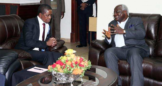 President Edgar Chagwa Lungu (r) listens to his Sierra Leone Counterpart Ernest Koroma during the meeting at David Livingstone Safari Lodge in Livingstone, Zambia on Friday, May 8,2015 -Picture by EDDIE MWANALEZA/STATE HOUSE