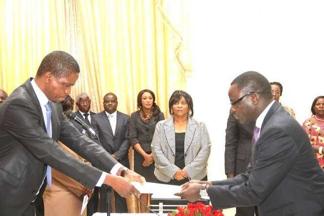 President Edgar Lungu receives an affidavit of Oath from Zambia's Ambassador to France Humphrey Chibanda during the swearing -In-Ceremony at State House on May 4,2015 -Picture by THOMAS NSAMA