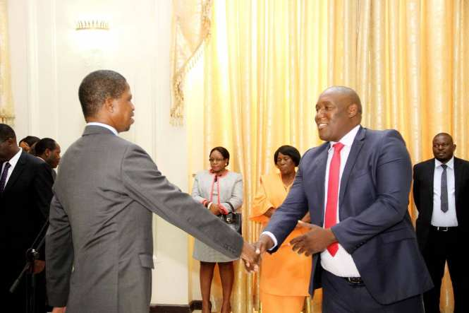President Lungu congratulates his Special Assistant for Legal Affairs Sukwana Lukangaba during the swearing in ceremony at State house on May 7,2015 -Picture by THOMAS NSAMA