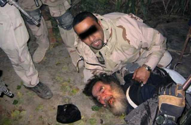 This unsourced picture shows ousted Iraqi leader Saddam Hussein being dragged from hiding following his capture by US troops