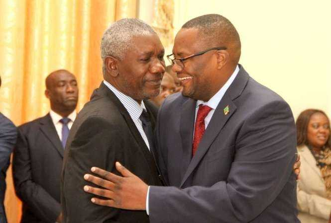 Zambia's High Commissioner to South Africa Emmanuel Mwamba (r) being congratulated by State House Senior Private Secretary Ogeon Gondwe during the swearing -In-Ceremony at State House on May 4,2015 -Picture by THOMAS NSAMA