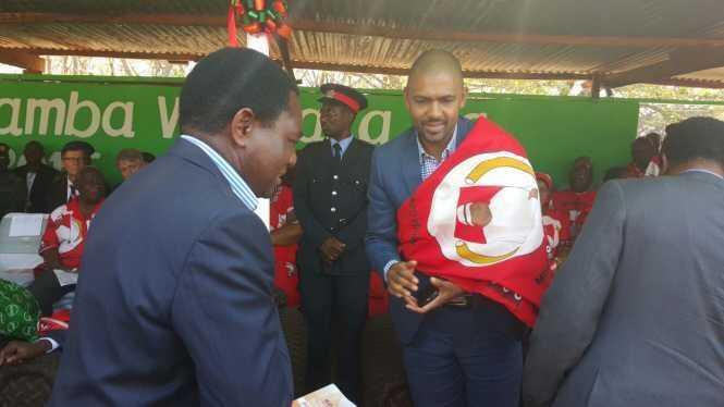 HH greets Vincent Mwale at