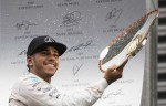 Mercedes Formula One driver Lewis Hamilton of Britain (L) celebrates his victory in the Belgian F1 Grand Prix in Spa-Francorchamps August 23, 2015. REUTERS:YVES HERMAN
