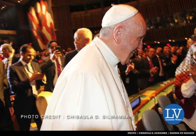 Pope Francis walks past the Zambia seat in the United Nations General Assembly Hall in New York, USA on Friday 25 September, 2015. PHOTO | CHIBAULA D. SILWAMBA | ZAMBIA UN MISSION