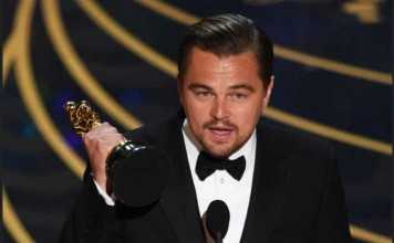 Leonardo DiCaprio accepts the award for best actor in The Revenant
