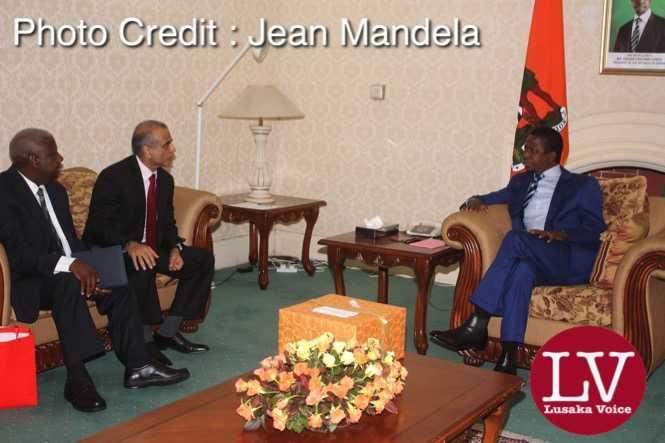 President Edgar Chagwa Lungu conferring  with Bharti Airtel CEO and Chairman Sunil Bharti Mittal   while looking on is Airtel  Networks Zambia Plc Board Chairman  George Sokota.