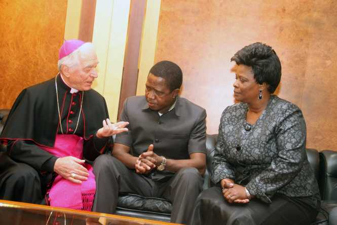 President Lungu and First Lady Esther Lungu listens to Apostolic Nuncio Joseph Canalini on arrival at FCO,Flumicino Airport in Rome , Italy on Thursday, February 4,2016 -Picture by THOMAS NSAMA