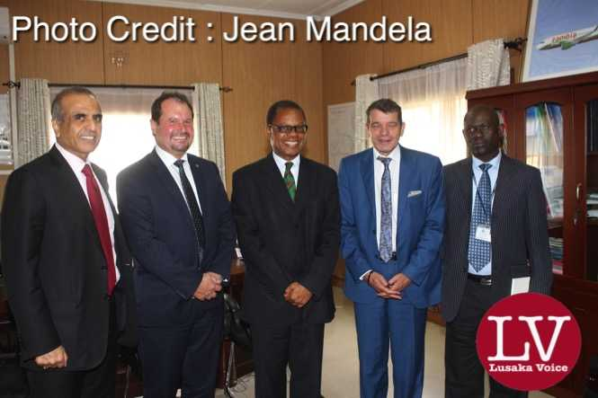 in a red tie Bharti Airtel CEO and Chairman Sunil Bharti Mittal visiting the Minister of Transport and communications Kampembwa  Simbao