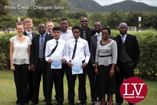 Mkushi District Education Standards Officer, Ms Eness Shooba (front row, far right) and Principal Andrew Cowling (last row, far left) with Karan, Munashe, Dalitso and their teachers (1)