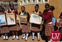 Kabulonga Girls pupils showing off their art work; the pupils were spotted at the school premises .