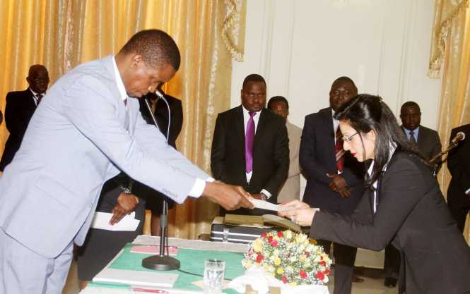 President Lungu receives an affidavit of Oath from newly appointed State Counsel Abha Nayar Patel during the Swearing-In-Ceremony at State House on Tuesday, June 14,2016