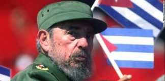 Cuban President Fidel Castro glances over his shoulder during the May Day conmemoration of Revolution Square in Havana May 1, 2004.