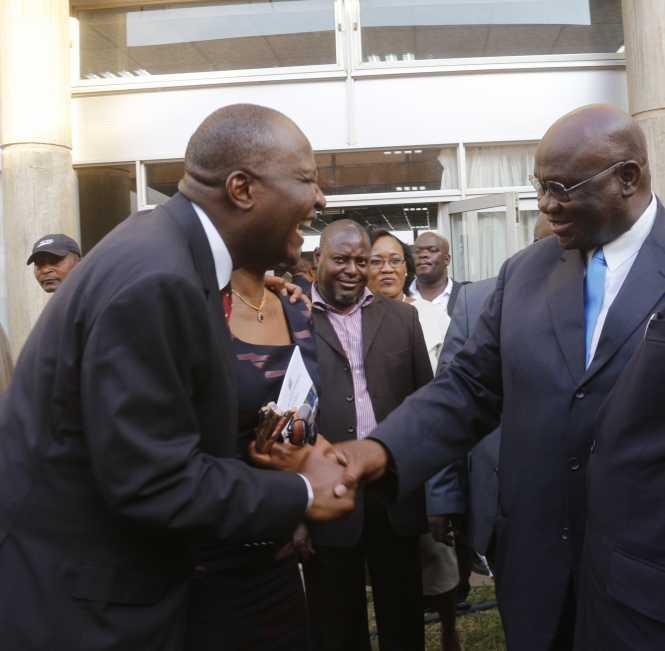 Finance Minister Felix Mutati interacting with Professor Geoffrey Lungwangwa