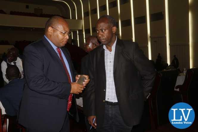 FAZ GS Ponga Liwewe having a chat with Football veteran administrator com coach Patrick Kangwa.